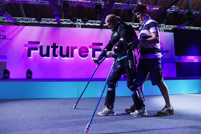Cyber-athlete Claire Lomas walks on stage at FutureFest 2016 in exoskeleton. *Photo courtesy of FutureFest